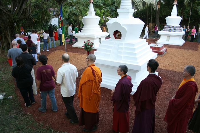 Garden of Merit Stupa Open Awareness Buddhist Center Miamibuddhism.com Feature Southernmost Tibetan stupas in the U.S. They were built to counter negativity and balance the elements, thereby benefiting the physical environment and all the beings sharing that environment. A basic design was shown by Buddha Shakyamuni when his disciples asked him how a reliquary should be constructed and what it should symbolize. The Kagyu lineage of Tibetan Buddhism has kept the basic design. These four stupas in Miami, Florida were built to face the four cardinal directions and symbolize various events in the life of the Buddha. Come experience the peace of our garden.